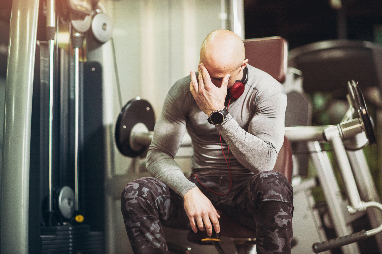 man-gym-sick-headache