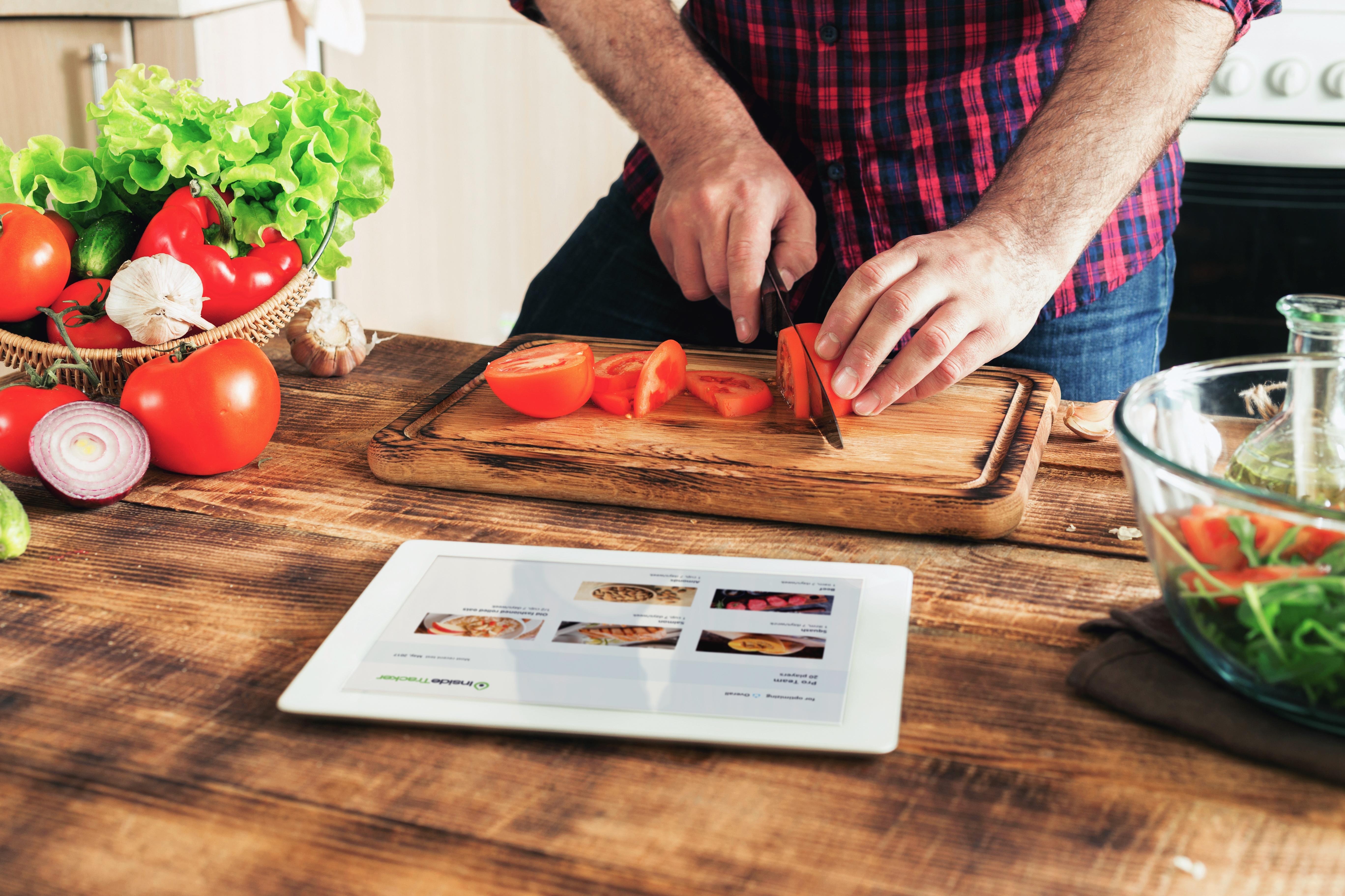 man_cooking_ipad_salad_vegetables.jpg